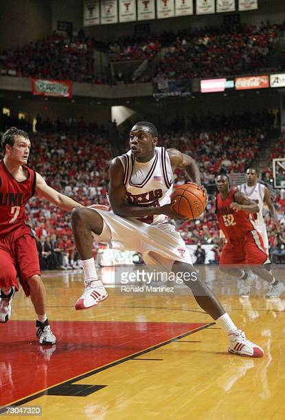 Martin Zeno of the Texas Tech Red Raiders moves to the basket against Kevin Kruger of the UNLV Rebels at United Spirit Arena on December 28 2006 in...