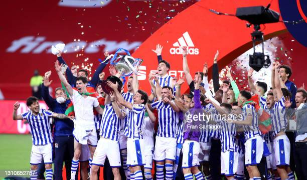 Martin Zubimendi and Mikel Oyarzabal of Real Sociedad lift the trophy after winning the Copa Del Rey Final match between Real Sociedad and Athletic...