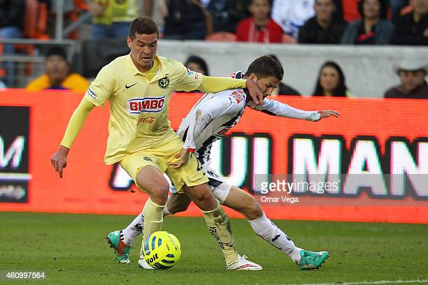 Martin Zuñiga of America struggles for the ball with Hiram Mier of Monterrey during a friendly match between America and Monterrey at BBVA Compass...