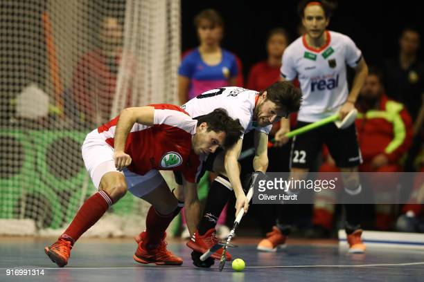 Martin Zwicker of Germany and Benjamin Stanzl of Austria compete for the ball during the Mens Gold Medal Indoor Hockey World Cup Berlin Final Day...