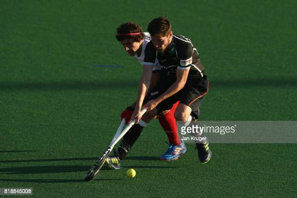 Martin Zwicker of Germany and Francois Goyet of France battle for possession during the Quarter final match between Germany and France during Day 6...