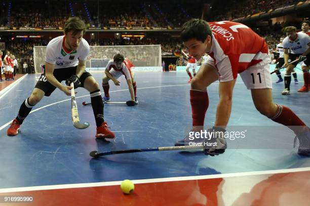 Martin Zwicker of Germany and Patrick Schmidt of Austria compete for the ball during the Mens Gold Medal Indoor Hockey World Cup Berlin Final Day...