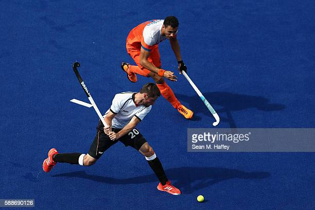 Martin Zwicker of Germany passes past Glenn Schuurman of Netherlands during a Men's Preliminary Pool B match on Day 7 of the Rio 2016 Olympic Games...