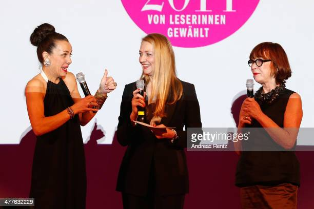 Martina Arfwidson, Andrea Ketterer and Gun Nowak pose with their awards during the Glammy Award by Glamour Magazine on March 6, 2014 in Munich,...