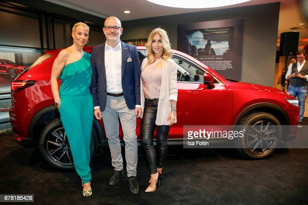Martina Borchert Dino Damiano and german actress and presenter Charlotte Wuerdig during the spring cocktail hosted by Mazda and InTouch magazine at...