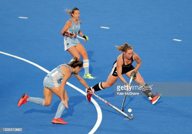 Martina Cavallero of Argentina and Selin Oruz of Germany battle for the ball during the Pool C game between Germany and Argentina of the FIH Womens...