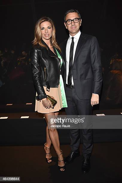 Martina Colombari and Alessandro Costacurta attend the Fausto Puglisi show during the Milan Fashion Week Autumn/Winter 2015 on February 25 2015 in...