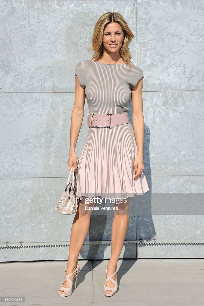 Martina Colombari attends the runway at the Emporio Armani Autumn/Winter 2012/2013 fashion show as part of Milan Womenswear Fashion Week on February 25, 2012 in Milan, Italy.