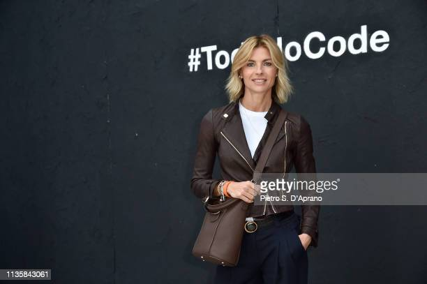 Martina Colombari attends Tod's - No Code Shelter: Stories of Contemporary Life on April 08, 2019 in Milan, Italy.