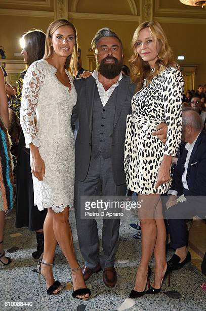 Martina Colombari Eliana Miglio and Ildo Damiano attend the Blumarine show during Milan Fashion Week Spring/Summer 2017 on September 24 2016 in Milan...
