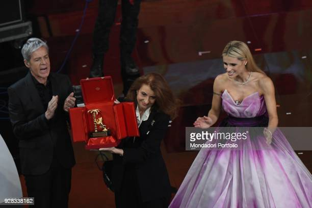 Martina Corgnati daughter of the italian singer Milva receive from the hands of the hosts Claudio Baglioni and Michelle Hunziker the career award...