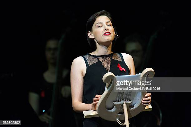 Martina Ebm reads on stage during the Red Ribbon Celebration Concert at Burgtheater on June 10 2016 in Vienna Austria The Red Ribbon Celebration...