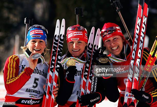 Martina Glagow , Andrea Henkel and Kati Wilhelm of Germany present their medals of the Women's 12.5 km Mass Start in the Biathlon World Championships...