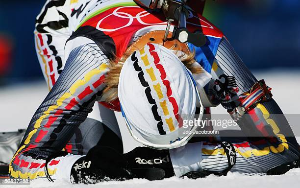 Martina Glagow of Germany collaspes at the finish line of the Womens Biathlon 15km Individual Final on Day 3 of the 2006 Turin Winter Olympic Games...