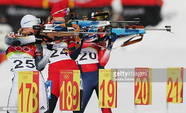 Martina Glagow of Germany Katerina Holubcova of Czech Republic and Tracy Barnes of the United States compete in the Womens Biathlon 75km Sprint Final...