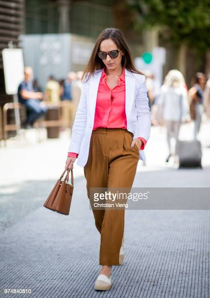 Martina Gronowska wearing linen jacket Massiom Dutti wool trousers line shirt Gucci sunglasses Michael Kors bag Gant espadrilles is seen during the...