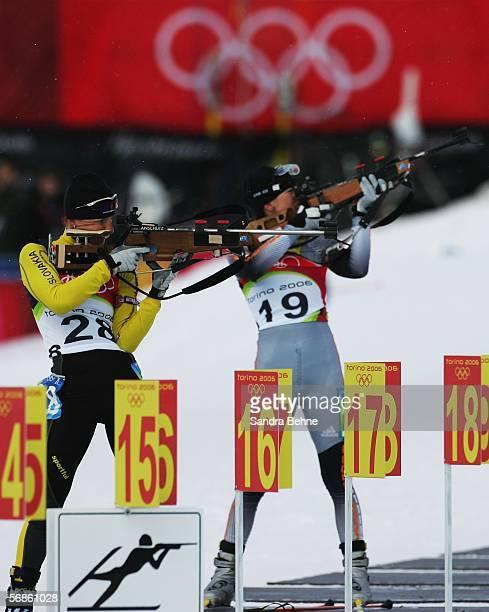 Martina Halinarova of Slovakia and Zsofia Goottschall of Hungary compete in the Womens Biathlon 75km Sprint Final on Day 6 of the 2006 Turin Winter...
