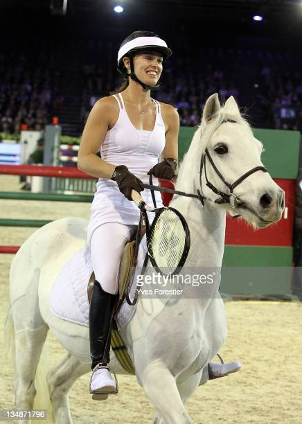 Martina Hingins in fancy dress rides during the International Gucci Masters competition on December 2 2011 in Villepinte France