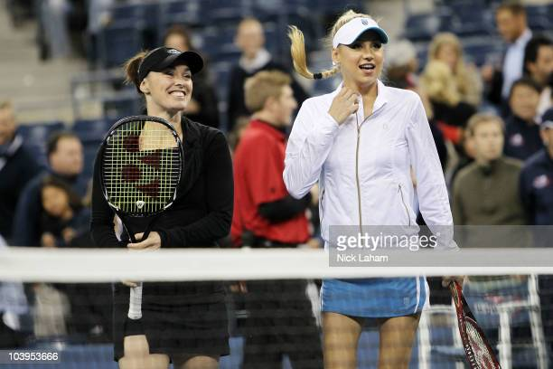 Martina Hingis and Anna Kournikova prepare to play against Pat Cash and Mats Wilander during day eleven of the 2010 US Open at the USTA Billie Jean...