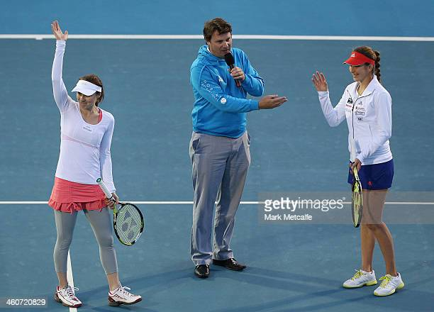 Martina Hingis and Belinda Bencic of Switzerland acknowledge the crowd after their exhibition match during day one of the Moorilla Hobart...
