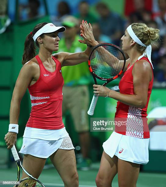 Martina Hingis and Timea Bacsinszky of Switzerland during their first round doubles match against Samantha Stosur and Daria Gavrilova of Australia on...