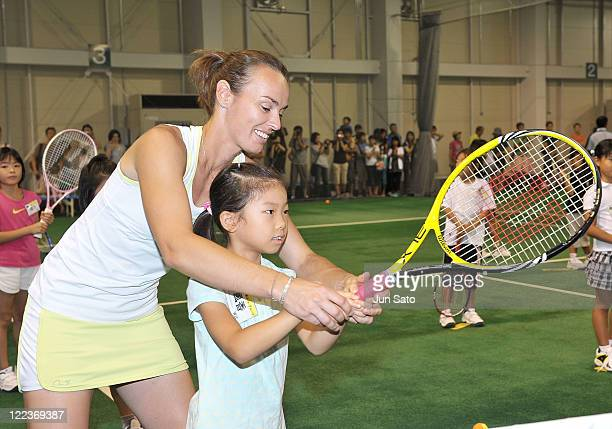 Martina Hingis demonstrates during the Yonex Youth Clinic at REC Indoor Tennis School on August 28 2011 in Tokyo Japan