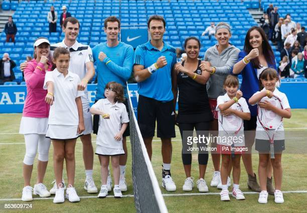 Martina Hingis Jamie Murray Andy Murray Ross Hutchins Heather Watson Victoria Azarenka and Laura Robson show off their rally for Bally wristbands as...