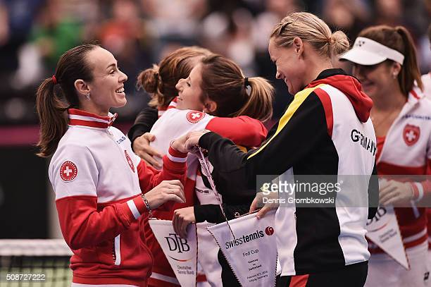 Martina Hingis of Switzerland and AnnaLena Groenefeld of Germany exchange pennants during Day 1 of the 2016 Fed Cup World Group First Round match...