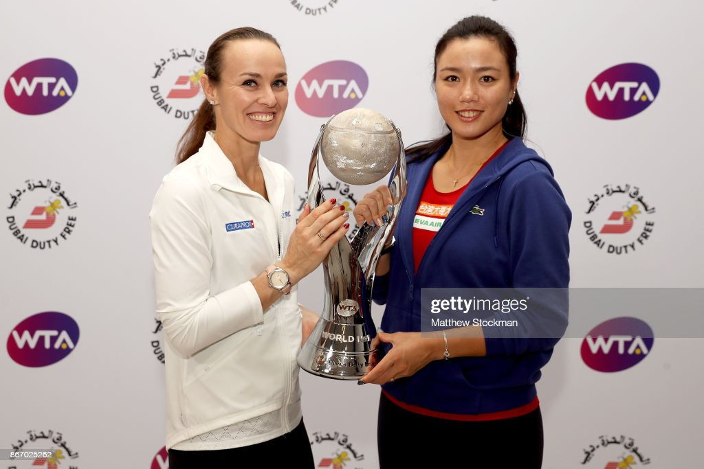 Martina Hingis of Switzerland and Chan Yung-Jan of Chinese Taipei pose with the WTA Year-End World No.1 Award presented by Dubai Duty Free during day 6 of the BNP Paribas WTA Finals Singapore presented by SC Global at Singapore Sports Hub on October 27, 2017 in Singapore.