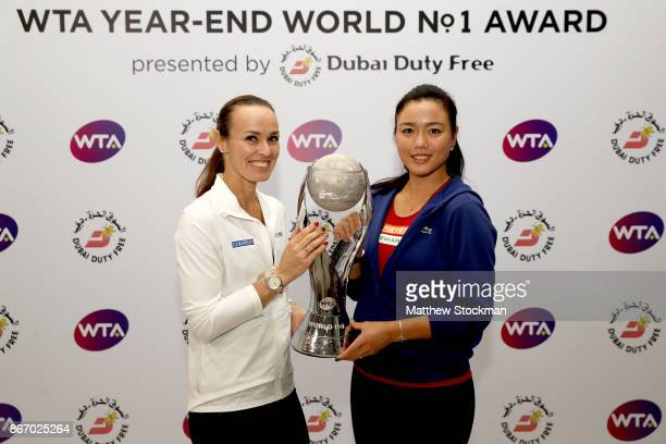 Martina Hingis of Switzerland and Chan YungJan of Chinese Taipei pose with the WTA YearEnd World No1 Award presented by Dubai Duty Free during day 6...