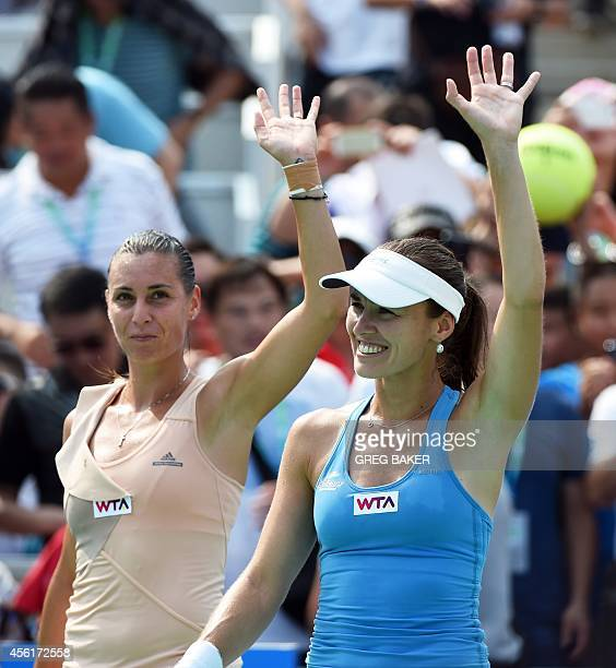 Martina Hingis of Switzerland and Flavia Pennetta of Italy celebrate after winning the doubles final at the Wuhan Open tennis tournament in Wuhan in...