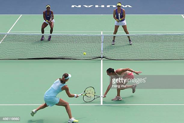 Martina Hingis of Switzerland and Flavia Pennetta of Italy in action during the doubles match againstRaquel KopsJones of USA and Abigail Spears of...