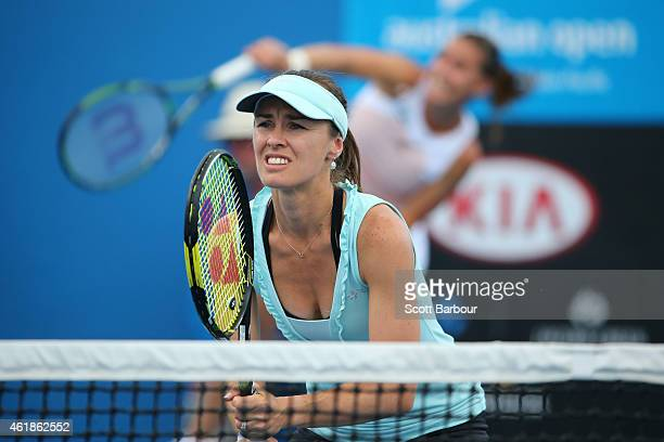Martina Hingis of Switzerland and Flavia Pennetta of Italy in action in their first round doubles match against Belinda Bencic of Switzerland and...