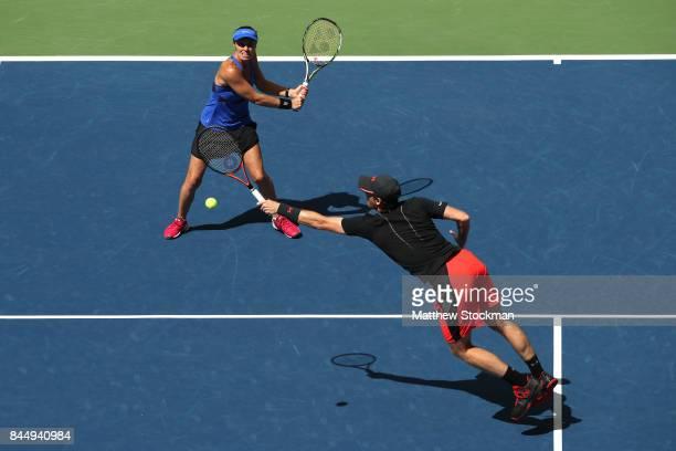 Martina Hingis of Switzerland and Jamie Murray of Great Britain return a shot against HaoChing Chan of Taiwan and Michael Venus of New Zealand during...