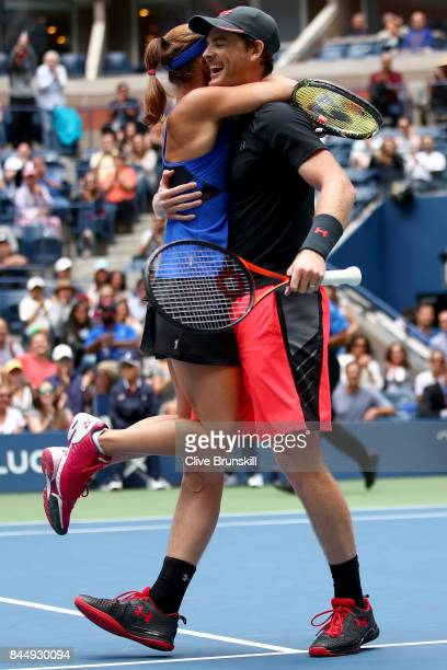Martina Hingis of Switzerland and Jamie Murray of Great Britain celebrate defeating HaoChing Chan of Taiwan and Michael Venus of New Zealand in their...