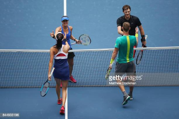 Martina Hingis of Switzerland and Jamie Murray of Great Britain shake hands after defeating HaoChing Chan of Taiwan and Michael Venus of New Zealand...