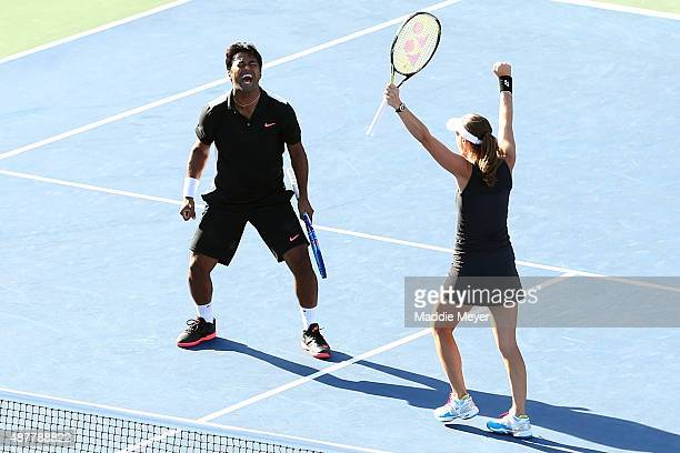 Martina Hingis of Switzerland and Leander Paes of India celebrate after defeating Bethanie MattekSands of the United States and Sam Querrey of the...