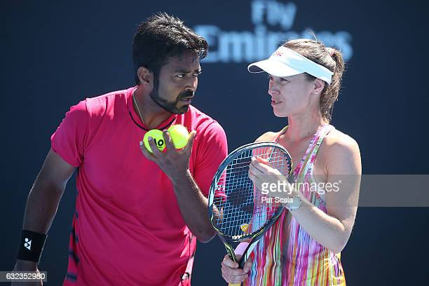 Martina Hingis of Switzerland and Leander Paes of India compete in their first round match against Destanee Aiava and Marc Polmans of Australia on...