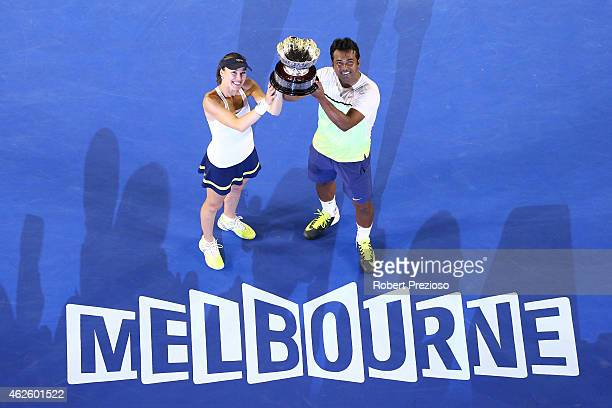 Martina Hingis of Switzerland and Leander Paes of India hold the winners trophy after their final mixed doubles match against Kristina Mladenovic of...