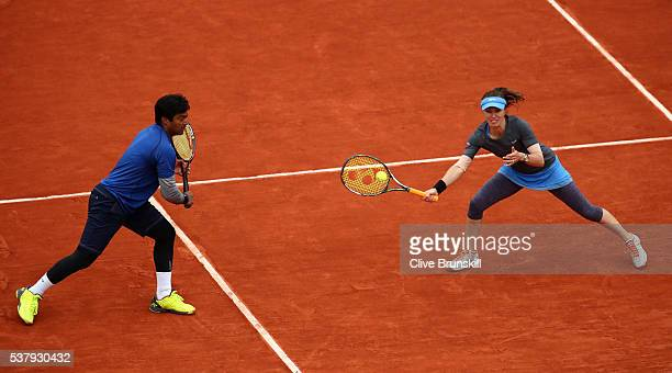 Martina Hingis of Switzerland and Leander Paes of India in action during the Mixed Doubles final match against Sania Mirza of India and Ivan Dodig of...