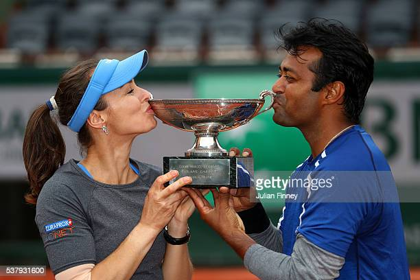 Martina Hingis of Switzerland and Leander Paes of India kiss the trophy following victory during the Mixed Doubles final match against Sania Mirza of...