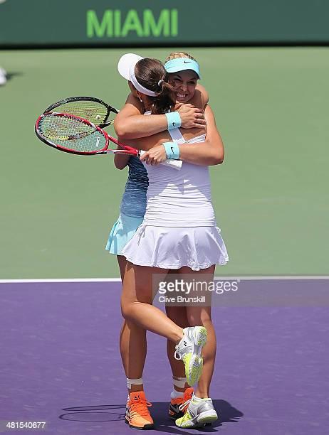 Martina Hingis of Switzerland and Sabine Lisicki of Germany celebrate match point against Ekaterina Makarova and Elena Vesnina of Russia during their...