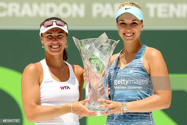 Martina Hingis of Switzerland and Sabine Lisiki of Germany pose for photographers with the Butch Buchholz Trophy after defeating Ekaterina Maka rova...