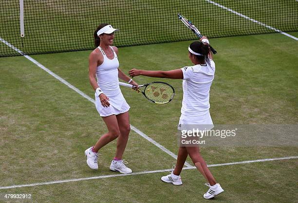 Martina Hingis of Switzerland and Sania Mirza of India celebrate in the Ladies' Doubles against Casey Dellacqua of Australia and Yaroslava Shvedova...