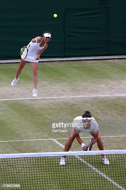 Martina Hingis of Switzerland and Sania Mirza of India in the Ladies' Doubles against Casey Dellacqua of Australia and Yaroslava Shvedova of...