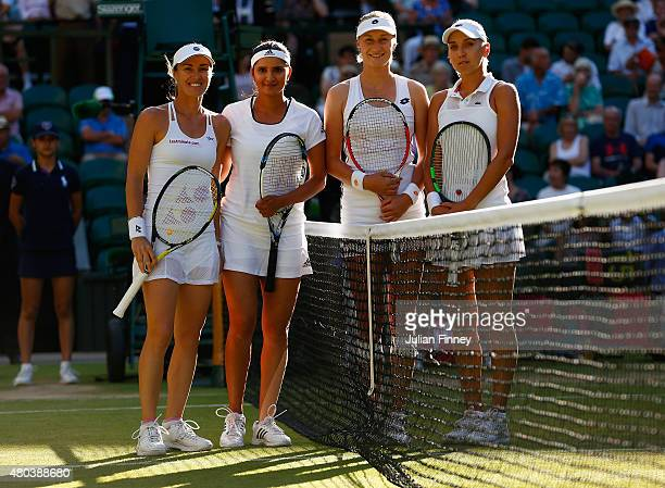 Martina Hingis of Switzerland and Sania Mirza of India line up at the net with Ekaterina Makarova of Russia and Elena Vesnina of Russia in the Final...