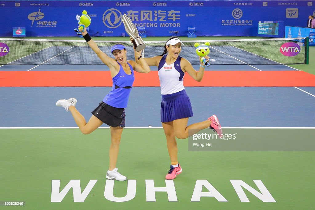 Martina Hingis of Switzerland and Yung Jan Chan of Chinese Taipei celebrate with the trophy following their victory during the Ladies Doubles final against Shuko Aoyama of Japan and Zhaoxuan Yang of China on day 7 of 2017 Dongfeng Motor Wuhan Open at Optics Valley International Tennis Center on September 30, 2017 in Wuhan, China.