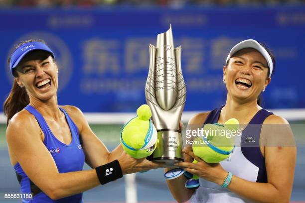 Martina Hingis of Switzerland and Yung Jan Chan of Chinese Taipei celebrate with the trophy following their victory during the Ladies Doubles final...