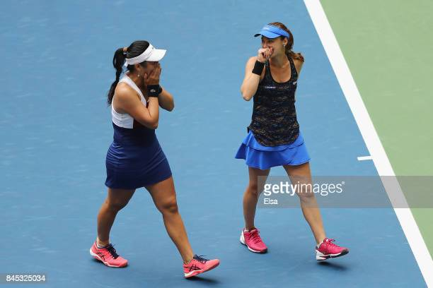 Martina Hingis of Switzerland and YungJan Chan of Taiwan celebrate defeating Lucie Hradecka of Czech Republic and Katerina Siniakova of Czech...