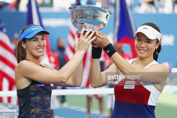 Martina Hingis of Switzerland and YungJan Chan of Taiwan hold the championship trophy after defeating Lucie Hradecka of Czech Republic and Katerina...